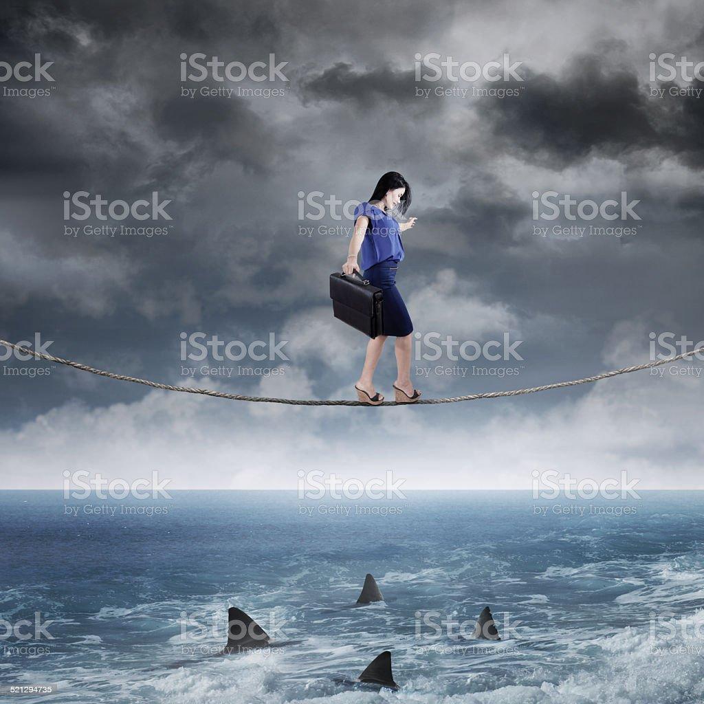 Businesswoman walk above ocean stock photo