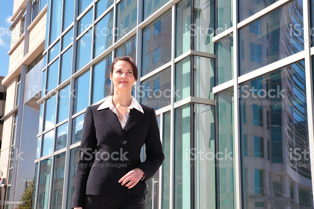 Businesswoman walking downtown royalty-free stock photo