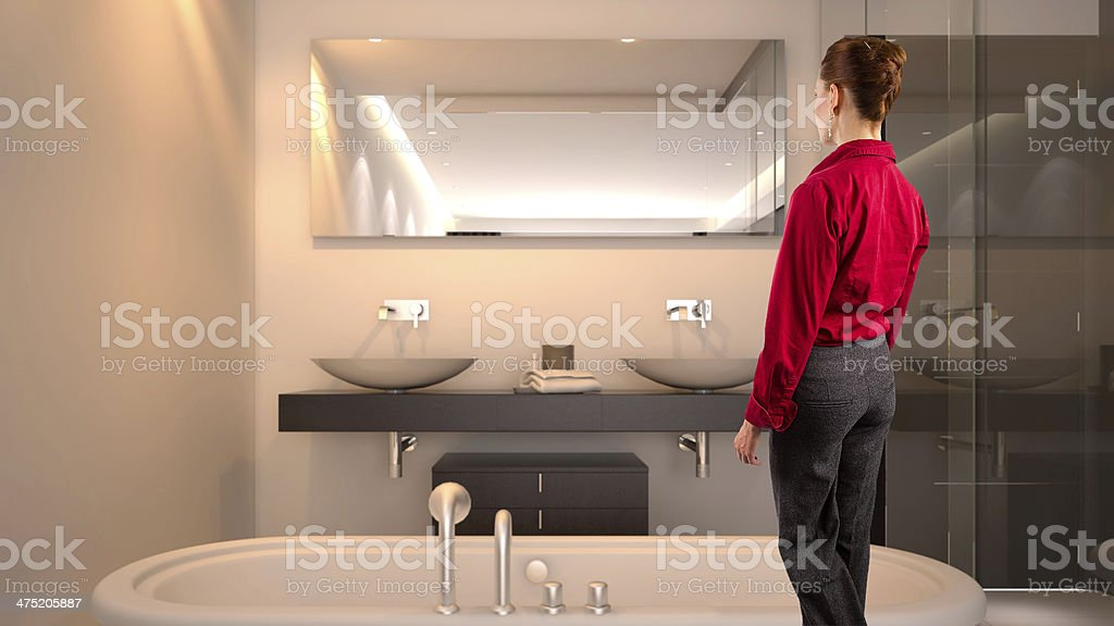 Businesswoman walking into a hotel room royalty-free stock photo