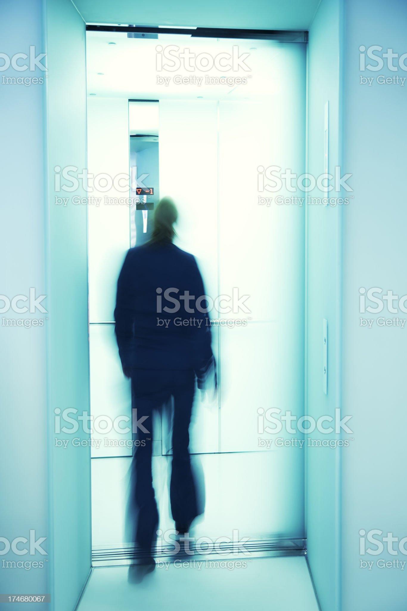 Businesswoman Walking Into Elevator royalty-free stock photo