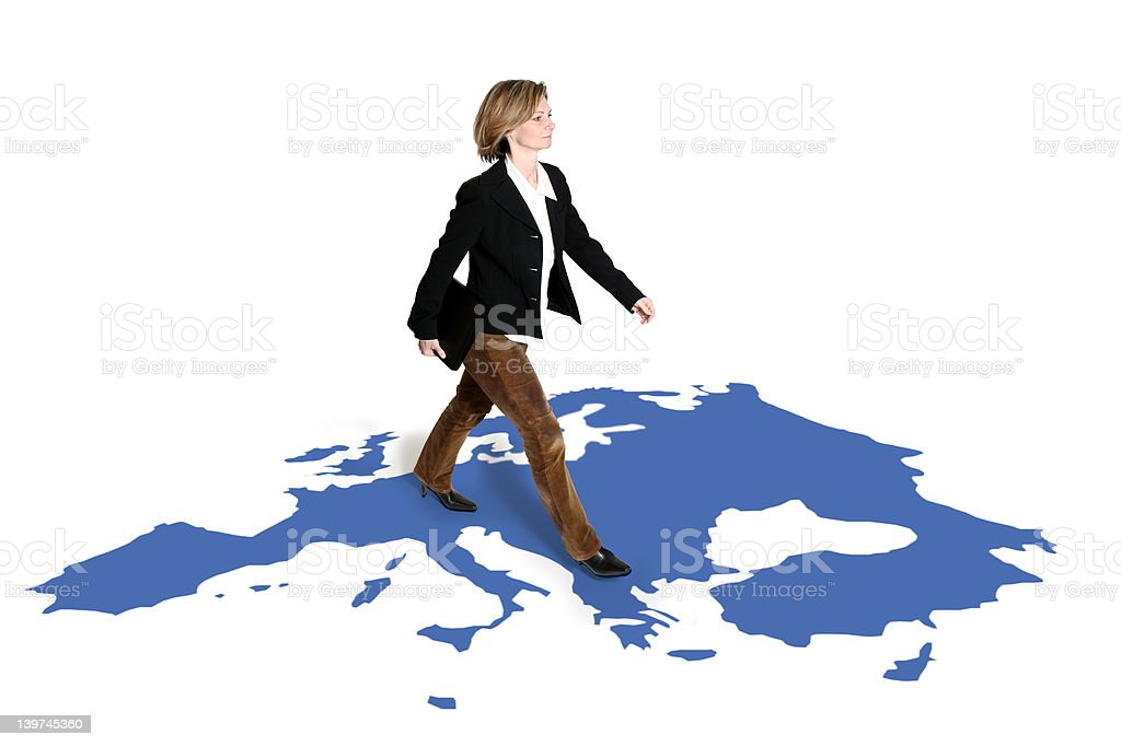 businesswoman walking on europe map royalty-free stock photo