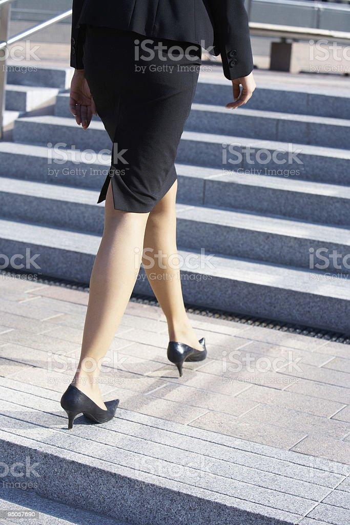 Businesswoman Walking on Stairway royalty-free stock photo