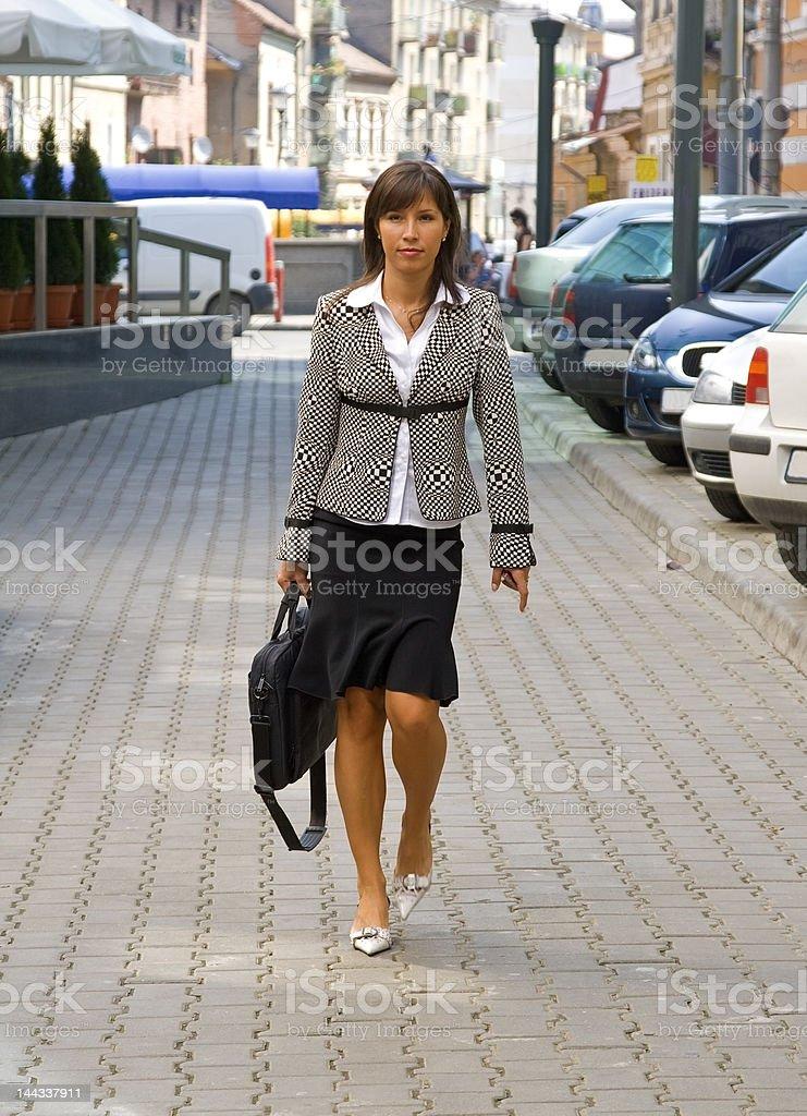 Businesswoman walking royalty-free stock photo