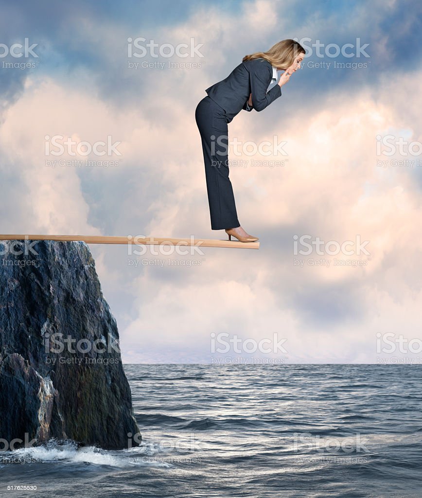 Businesswoman Walking the Plank stock photo