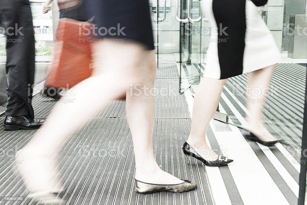 businesswoman walking to office stock photo