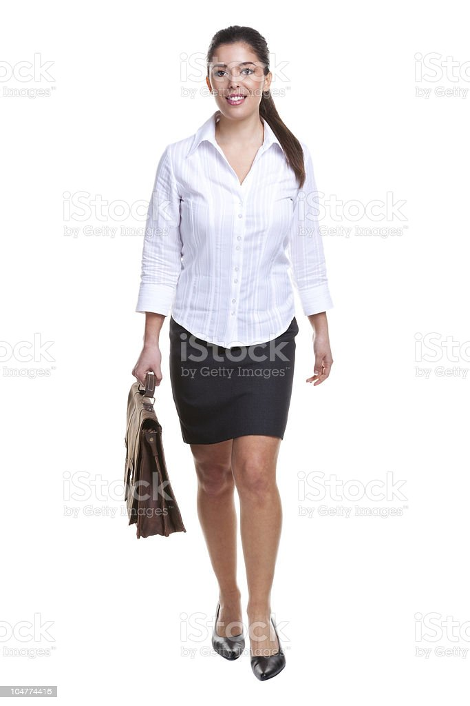 Businesswoman walking towards stock photo