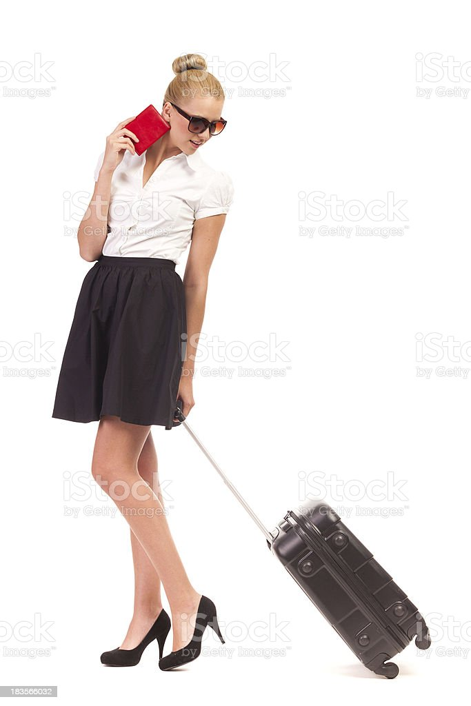 Businesswoman walking with trolley suitcase. royalty-free stock photo