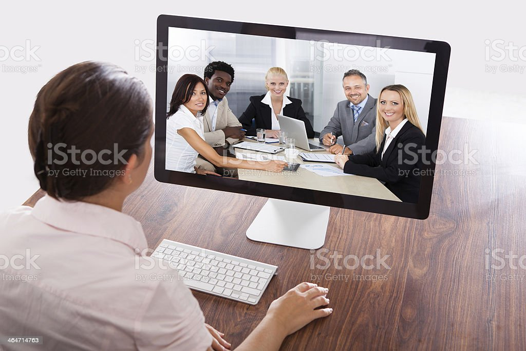 Businesswoman Watching An Online Presentation royalty-free stock photo