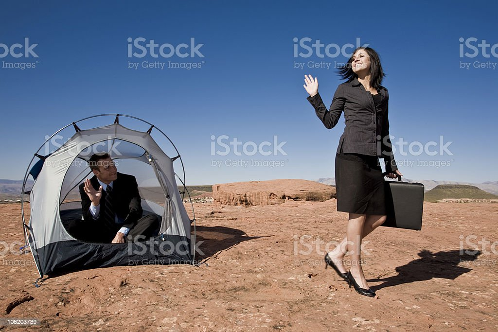 businesswoman waving goodbye from tent stock photo