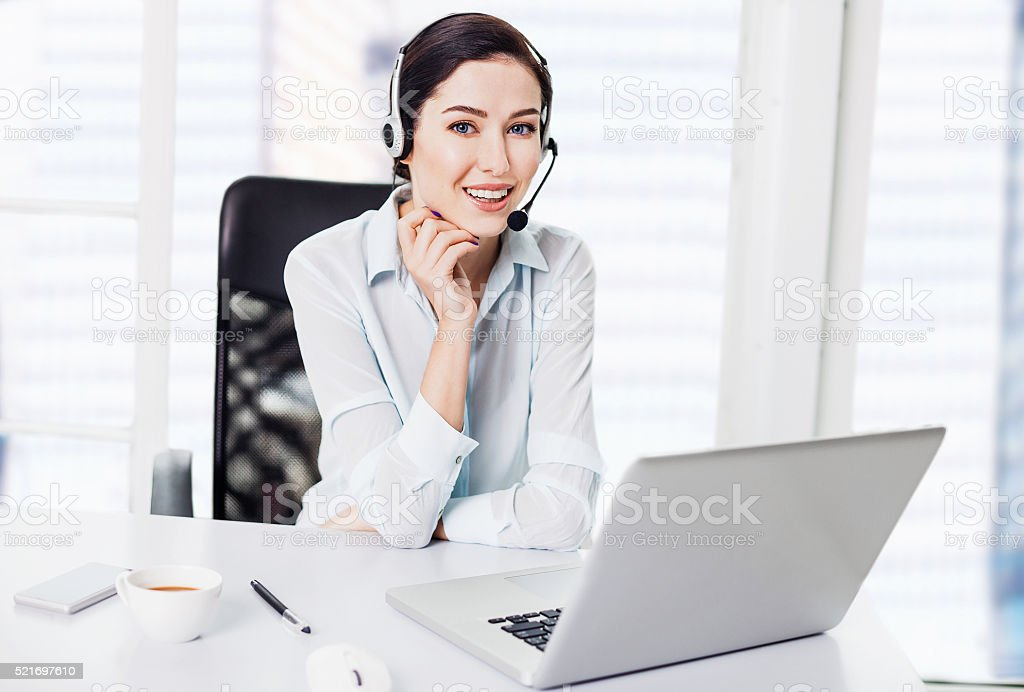 Businesswoman wearing a headset stock photo
