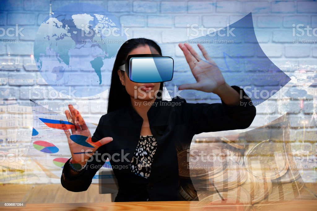 Businesswoman wearing a three-dimensional glasses working techno stock photo