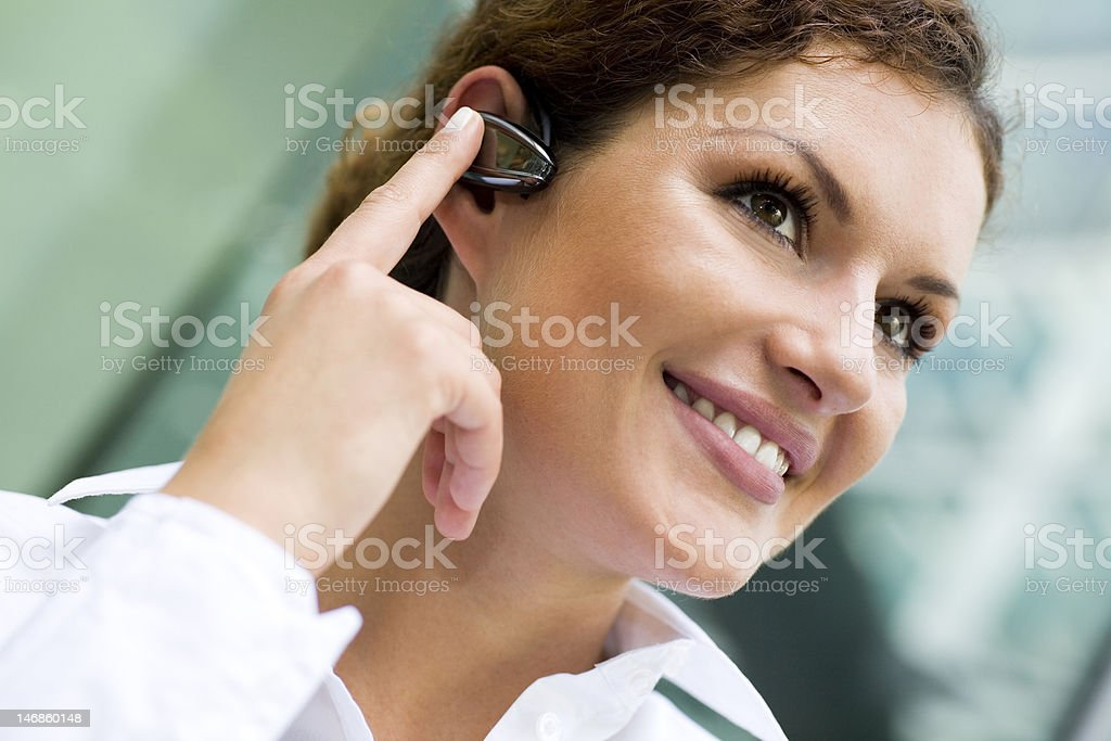 Businesswoman wearing bluetooth royalty-free stock photo