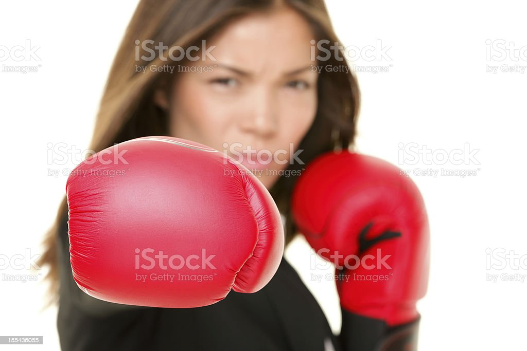 Businesswoman wearing boxing gloves stock photo