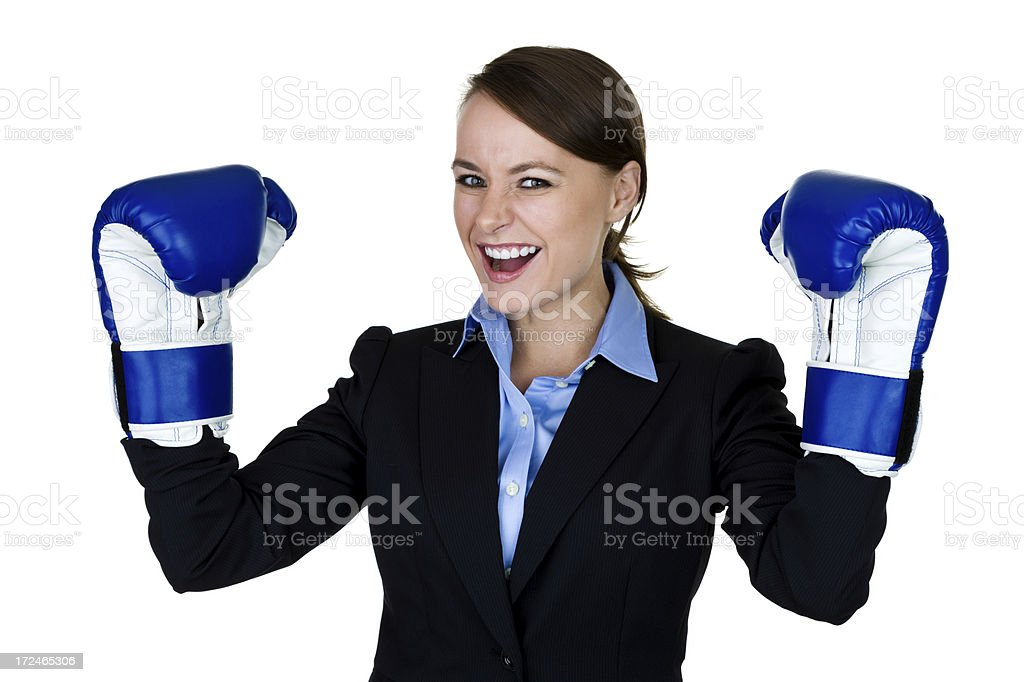 Businesswoman wearing boxing gloves royalty-free stock photo