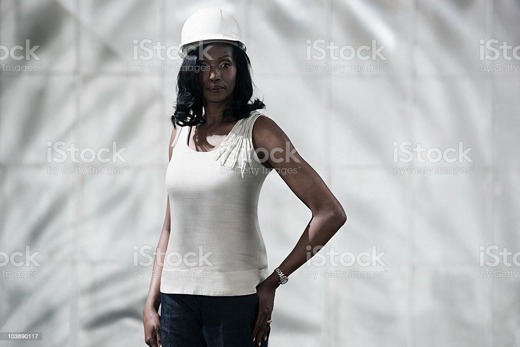 Businesswoman wearing hard hat stock photo