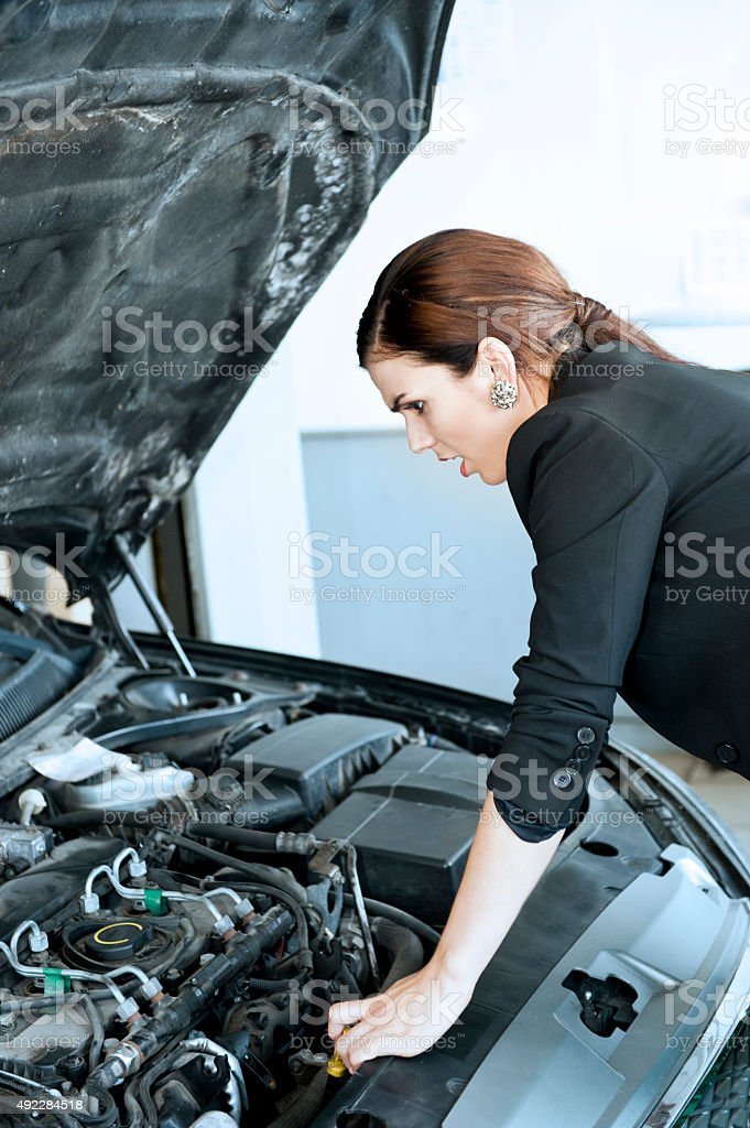 Businesswoman with a car breakdown stock photo