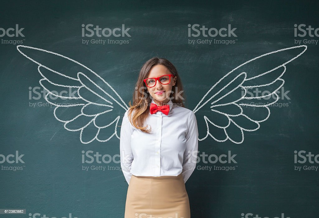 Businesswoman with angel wings stock photo