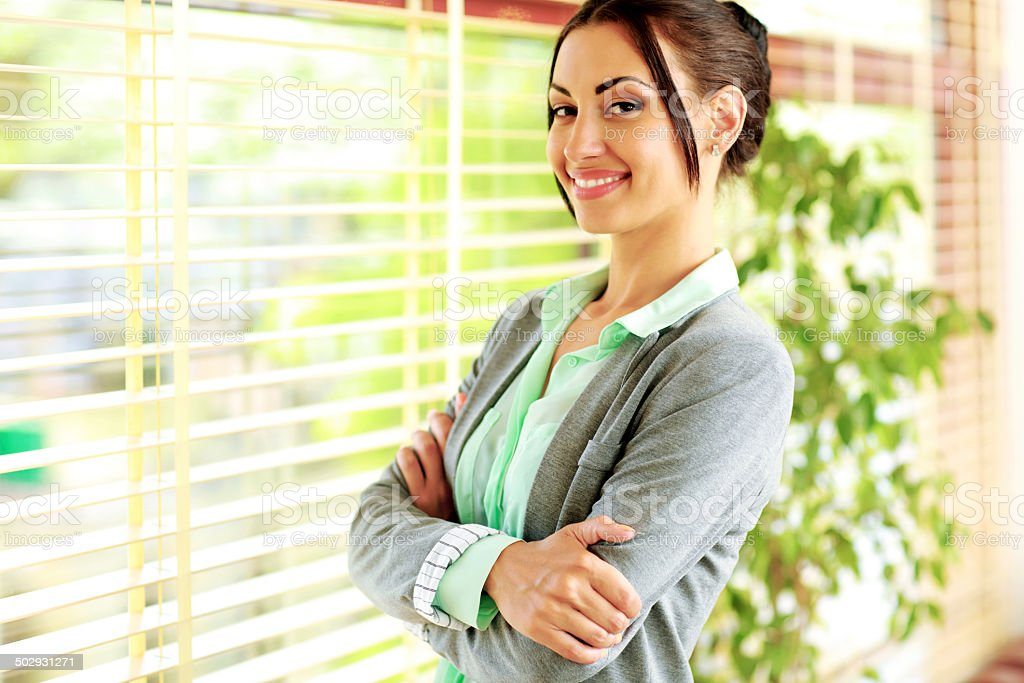 businesswoman with arms folded stock photo