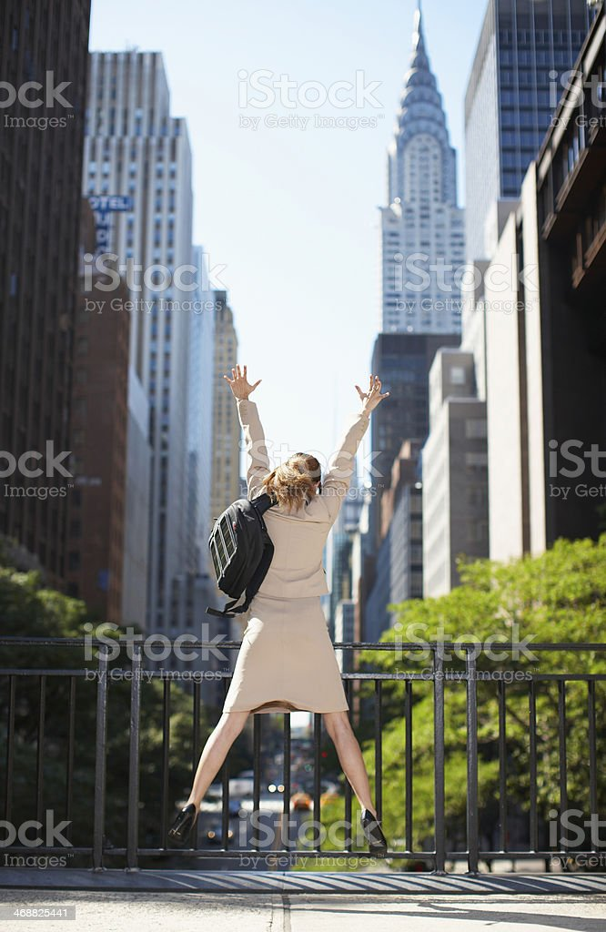 Businesswoman with Backpack Jumping stock photo