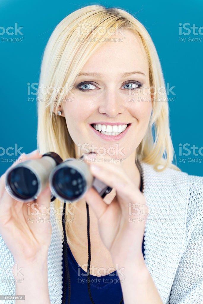 Businesswoman with binoculars royalty-free stock photo