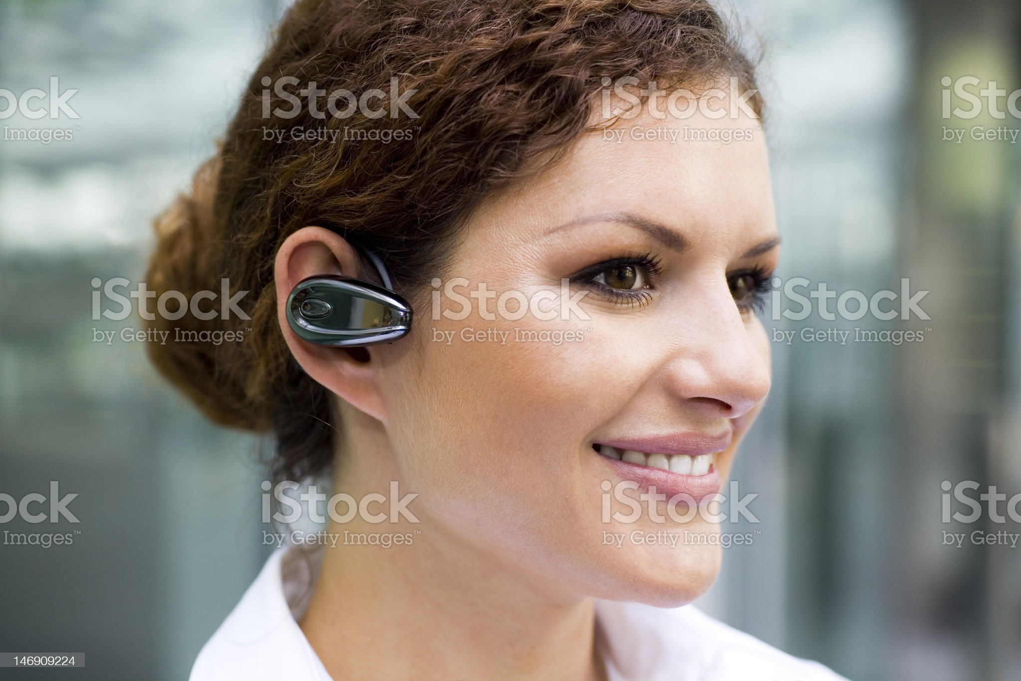 Businesswoman with bluetooth headset royalty-free stock photo