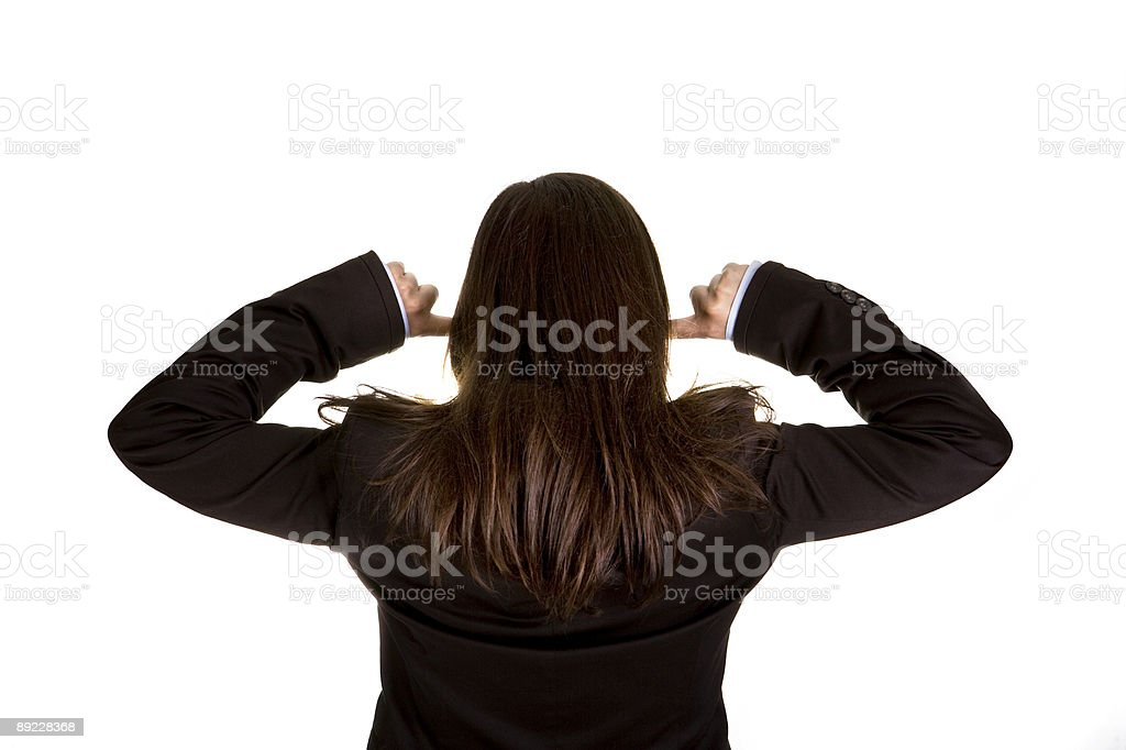 businesswoman with both fingers in the ears royalty-free stock photo