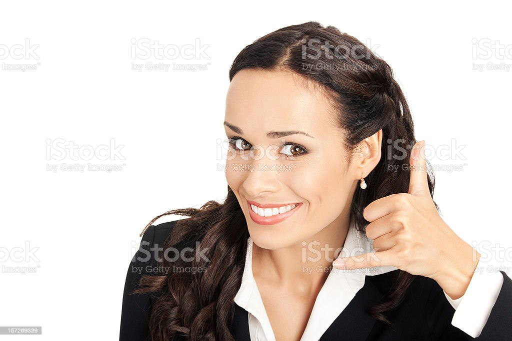 Businesswoman with call me gesture stock photo