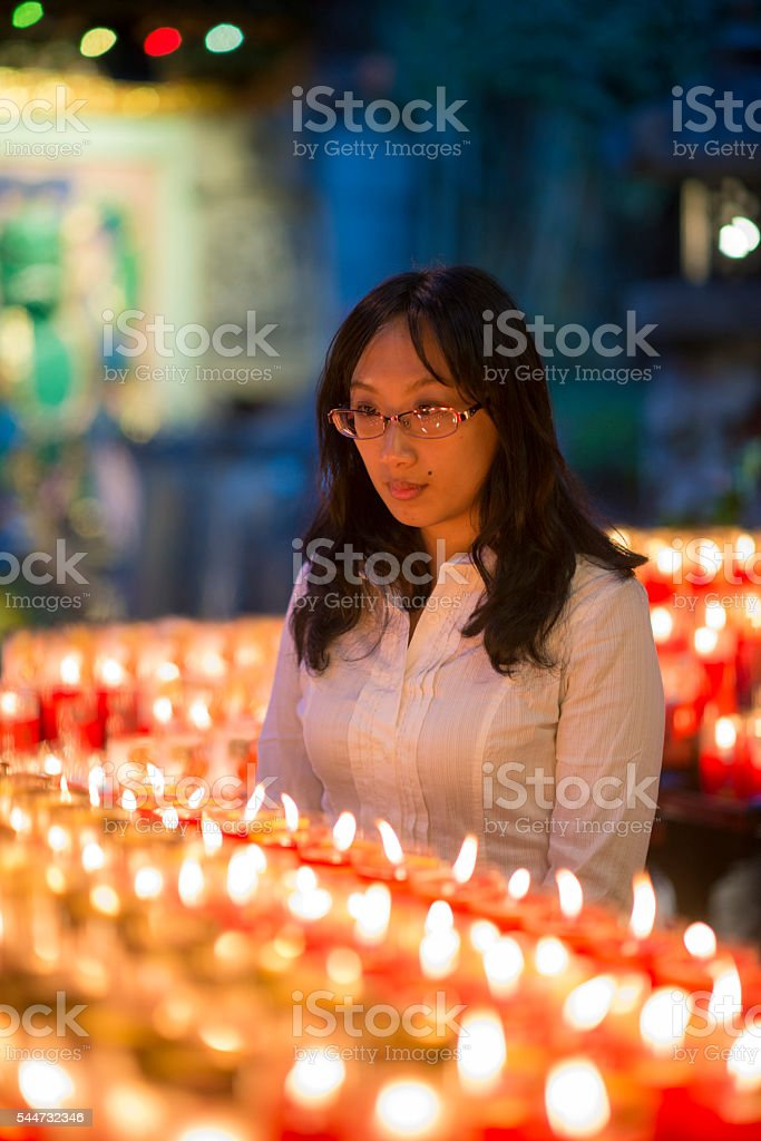 Businesswoman with candles in temple. stock photo