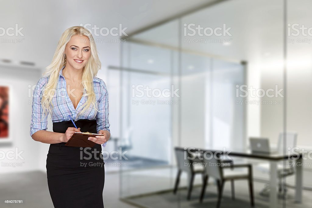 Businesswoman with checklist; teeth smile royalty-free stock photo