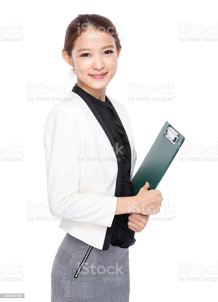 Businesswoman with clipboard stock photo