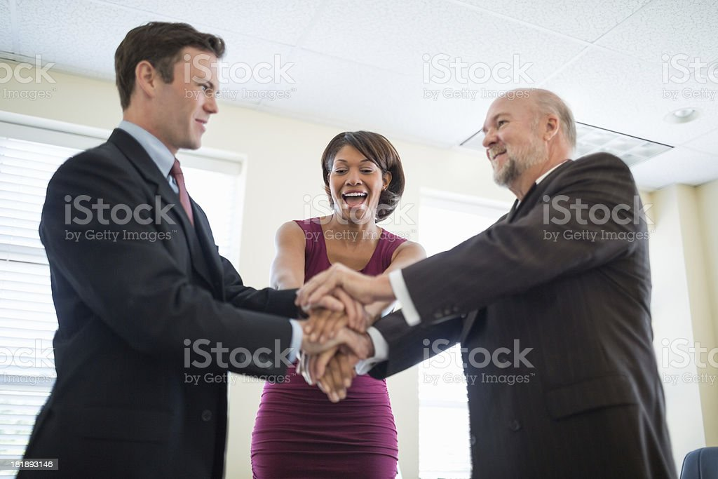 Businesswoman With Colleagues Stacking Hands royalty-free stock photo