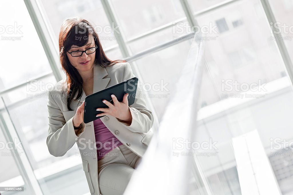 Businesswoman with digital tablet surfing the net royalty-free stock photo