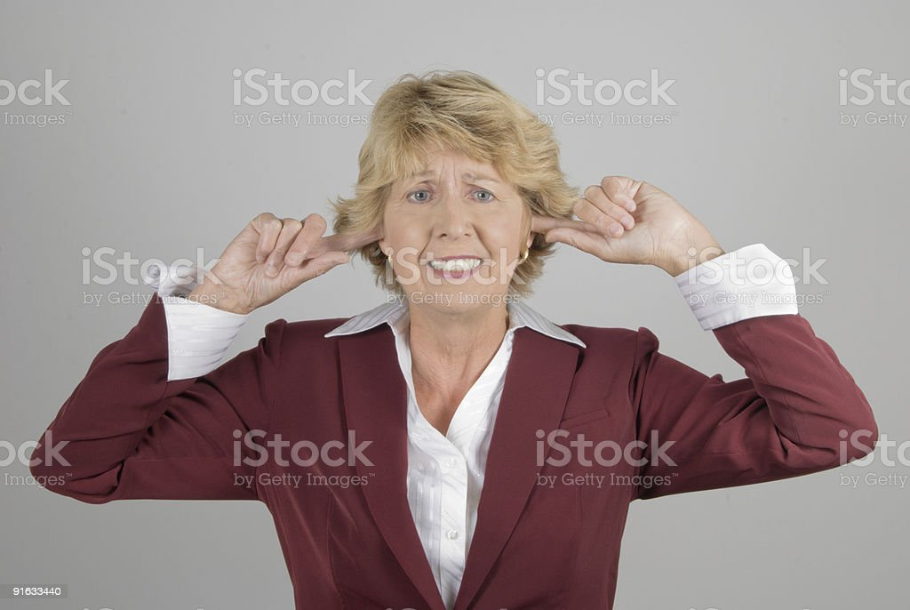 Businesswoman with fingers in ears royalty-free stock photo