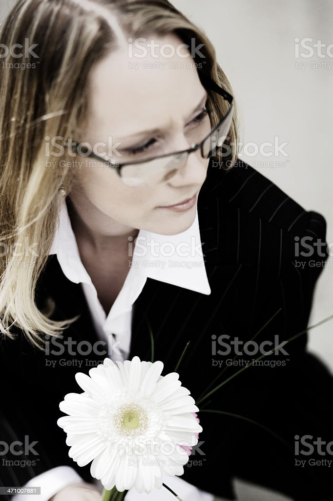 Businesswoman with flower stock photo