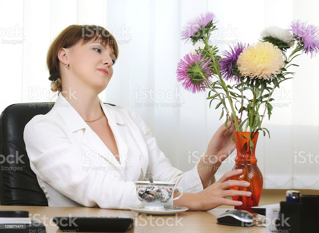 Businesswoman with flowers royalty-free stock photo