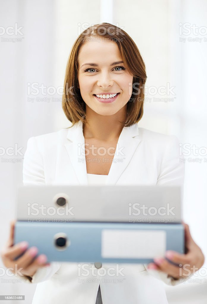 businesswoman with folders in office royalty-free stock photo