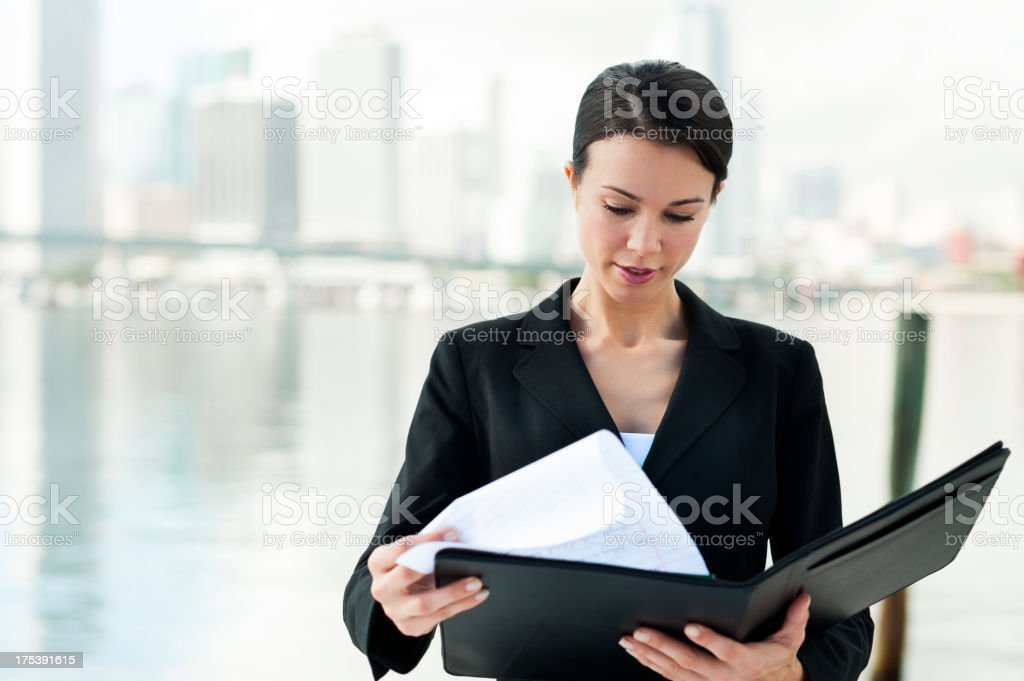 Businesswoman with Folio by Bay stock photo