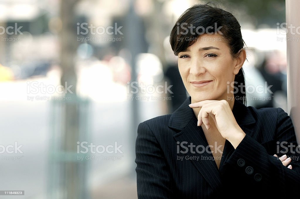 Businesswoman with Hand on Chin Financial District Street royalty-free stock photo