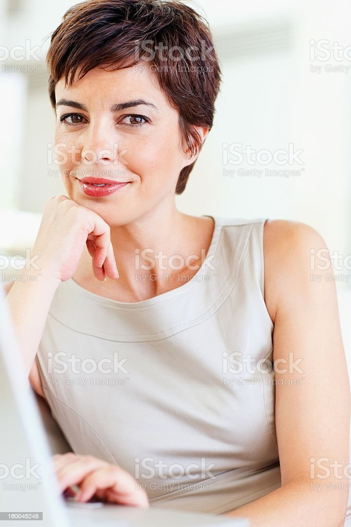 Businesswoman with hand on chin royalty-free stock photo