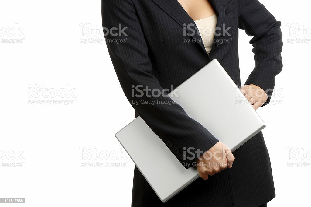 Businesswoman with hand on hip Holding Laptop White Background royalty-free stock photo