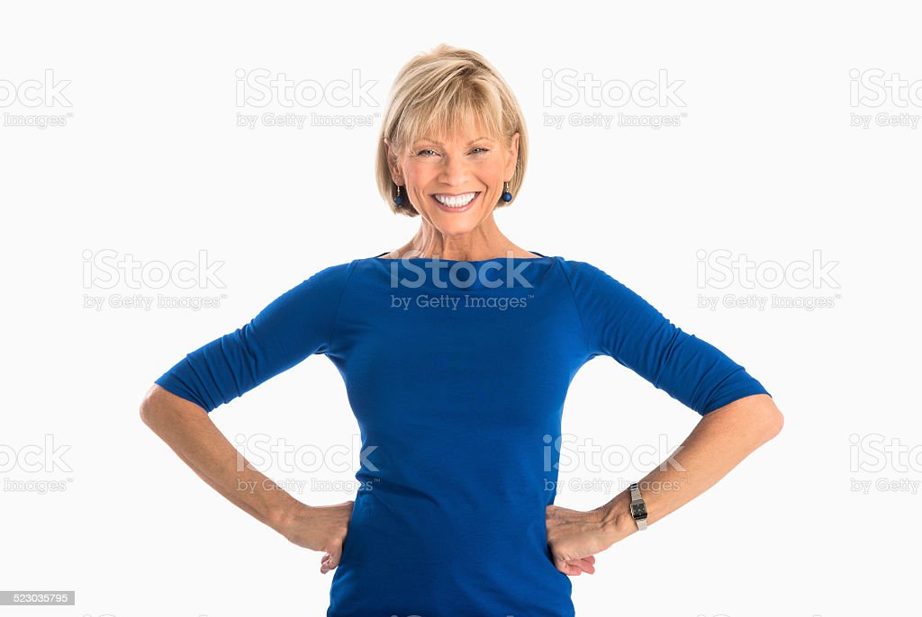 Businesswoman With Hands On Hip Over White Background stock photo