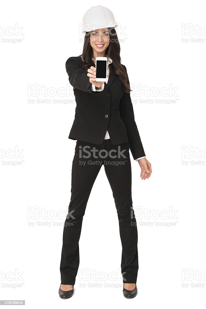 Businesswoman with Hardhat and Mobile Phone Isolated on White Background royalty-free stock photo