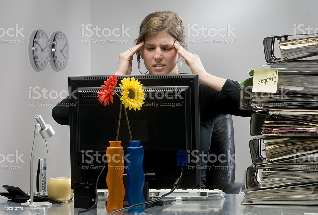 businesswoman with headache in office at work royalty-free stock photo