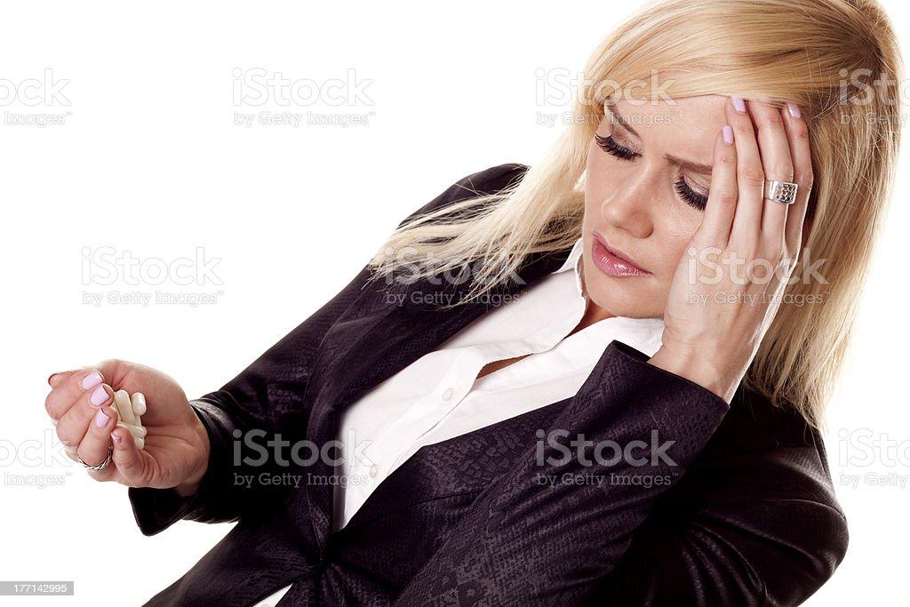 Businesswoman with headache. stock photo