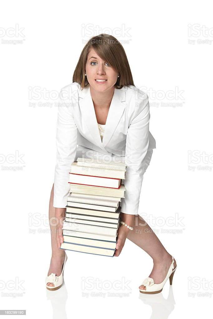 Businesswoman with heavy load of books royalty-free stock photo