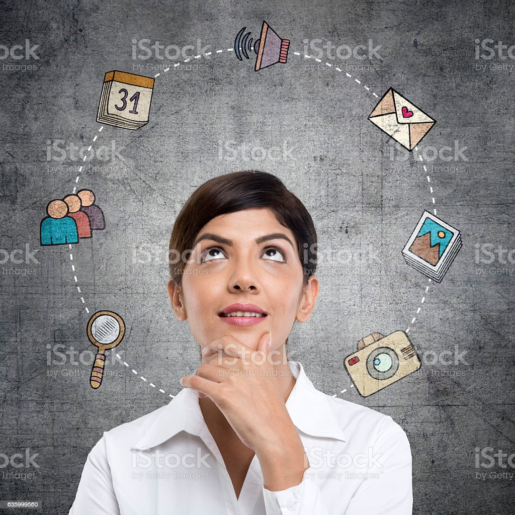 Businesswoman with infographic icons stock photo