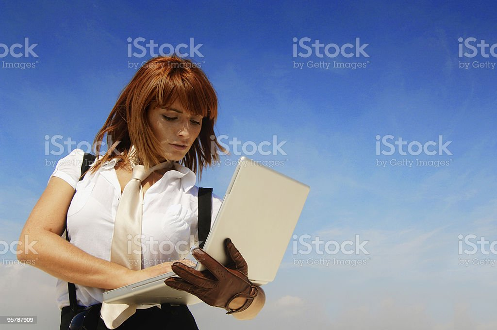 Businesswoman with laptop and blue sky royalty-free stock photo