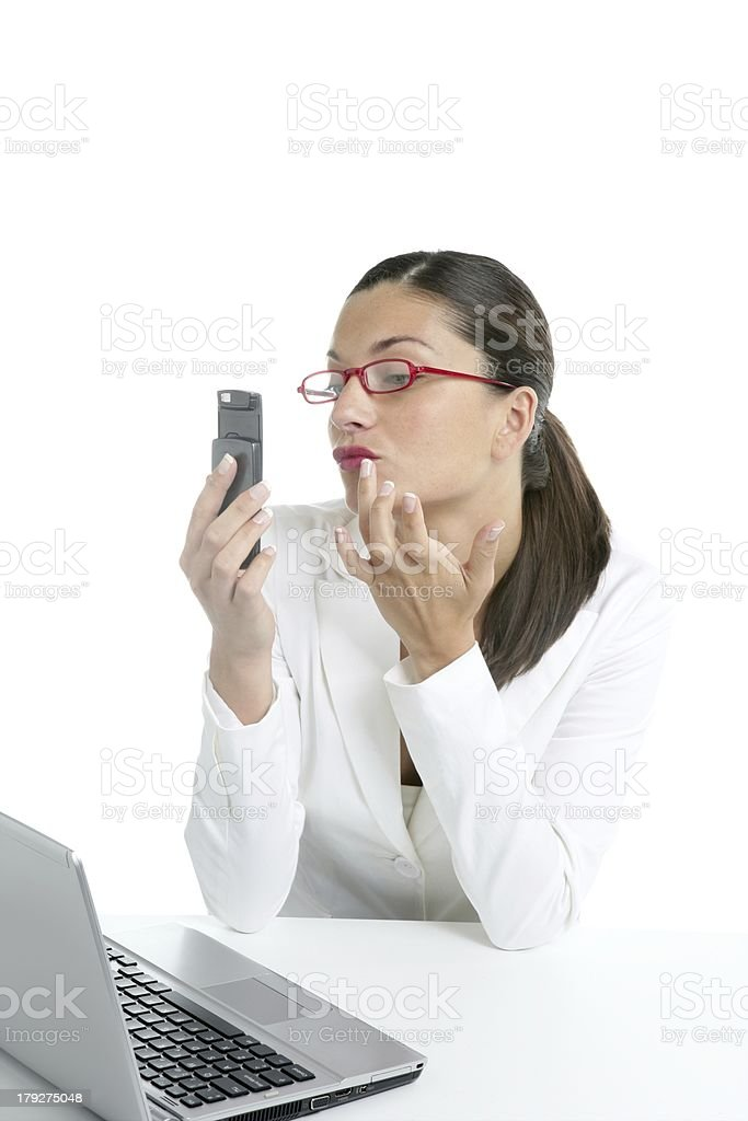 Businesswoman with lipstick and mobile phone royalty-free stock photo