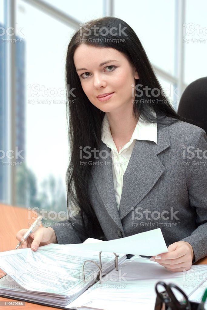 Businesswoman with long hair holding papers royalty-free stock photo