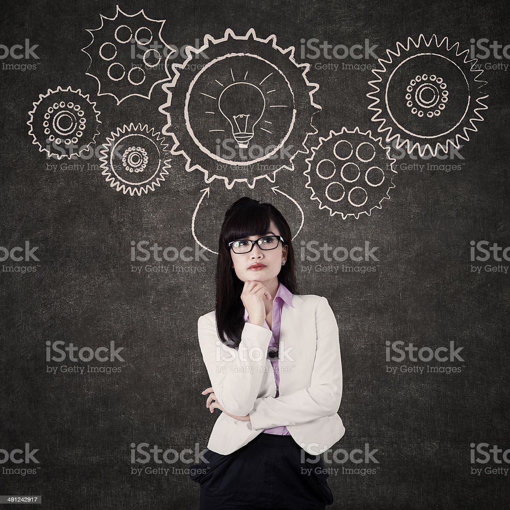 Businesswoman with mechanisms gear stock photo